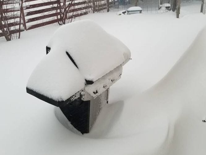 A grill covered in snow in Huron, South Dakota during a blizzard on Thursday, April 11, 2019.
