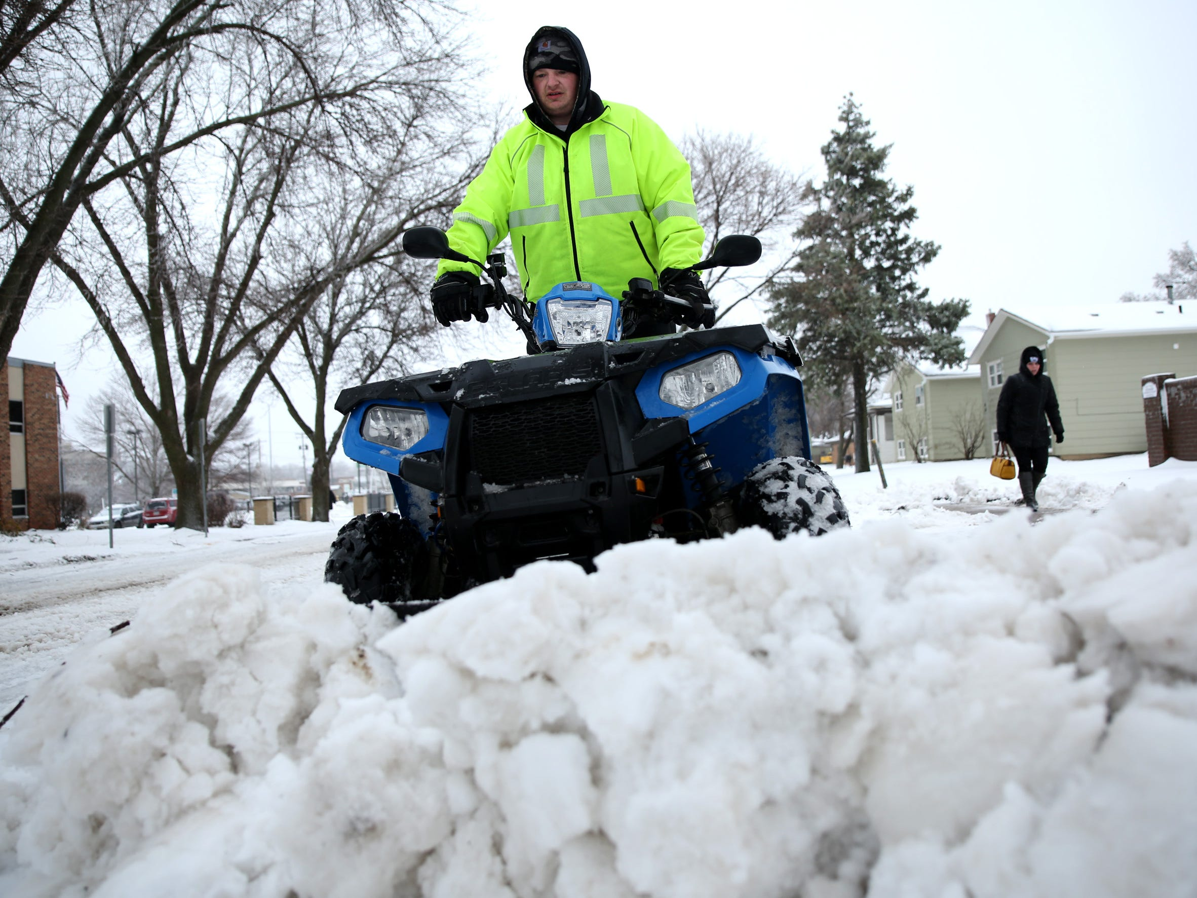 Dan Preston, owner of Mr. Plow, plows snow on a client's property on Spring Avenue Thursday, April 11 with a four-wheeler.