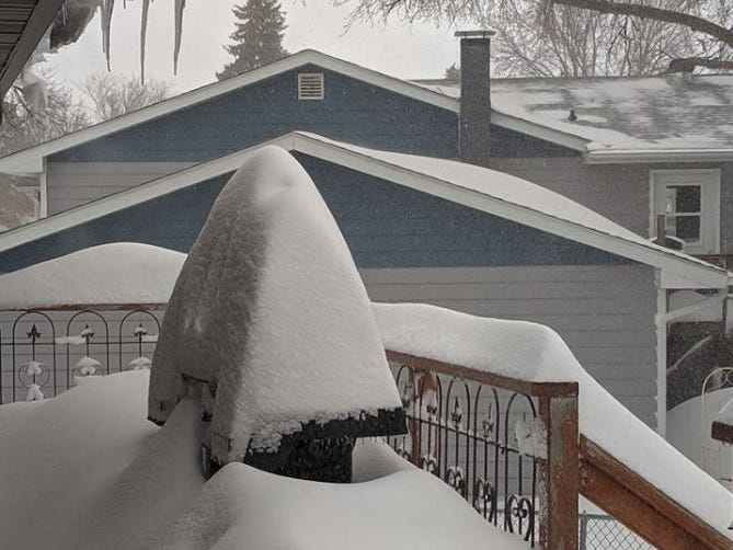 A porch buried in snow in Onida, South Dakota during a blizzard on Thursday, April 11, 2019.