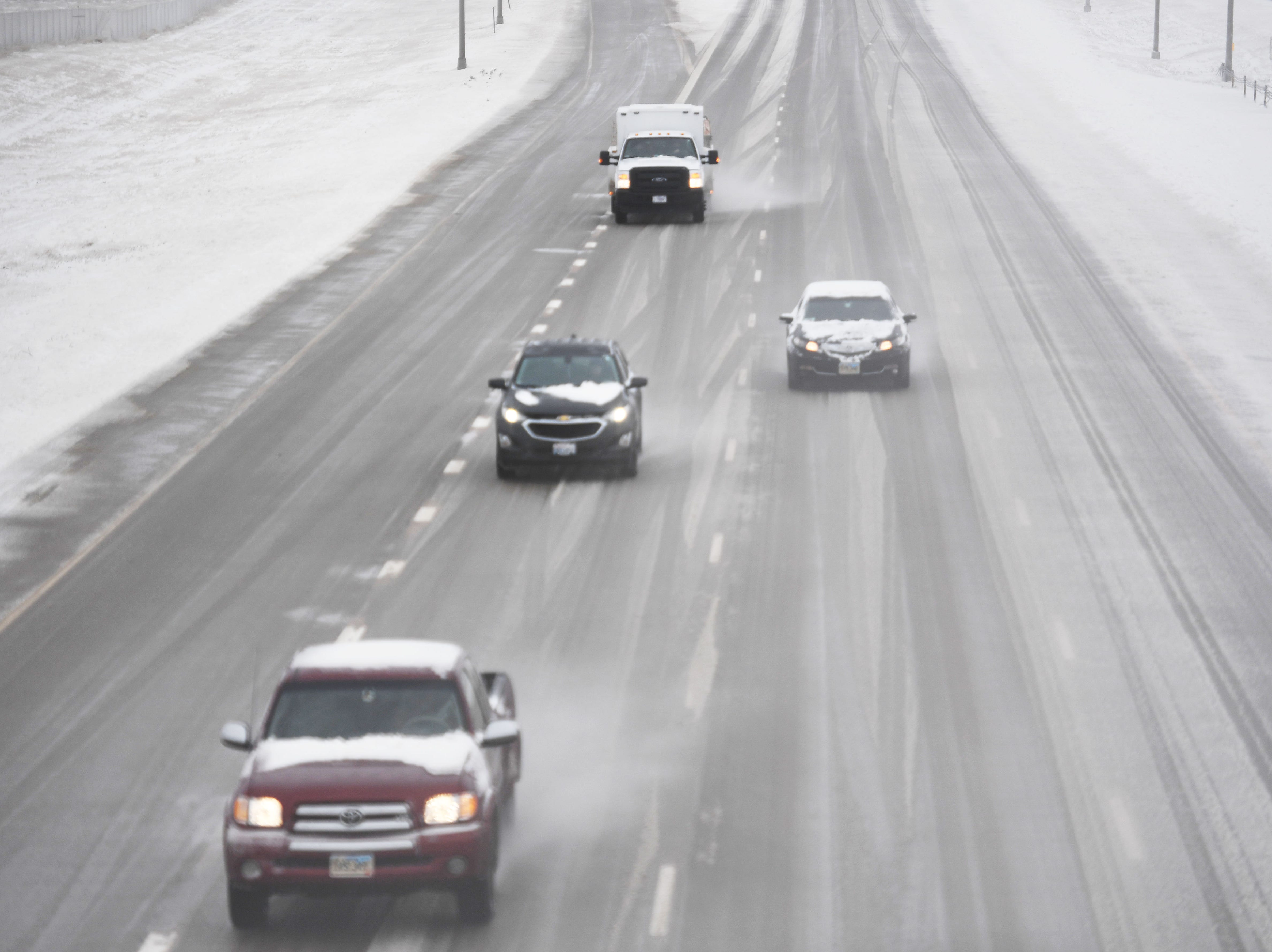 Cars travel on Interstate 29 Thursday, April 11, in Sioux Falls. I 29 is still closed from Sioux Falls to the North Dakota border, while Interstate 90 remains shuttered from Sioux Falls to New Underwood.