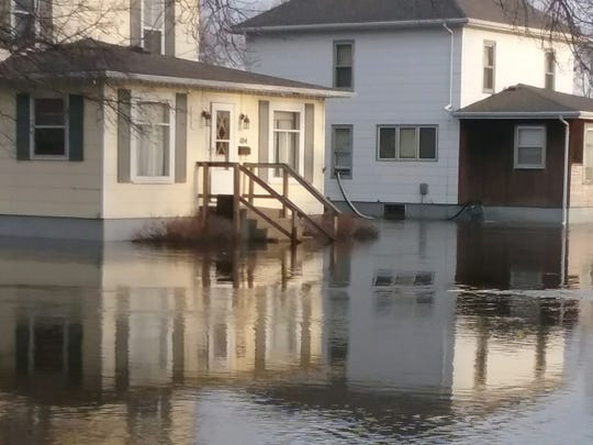 The home of Kelly and Megan Tiernan is swallowed up by the Big Sioux River in Dell Rapids.