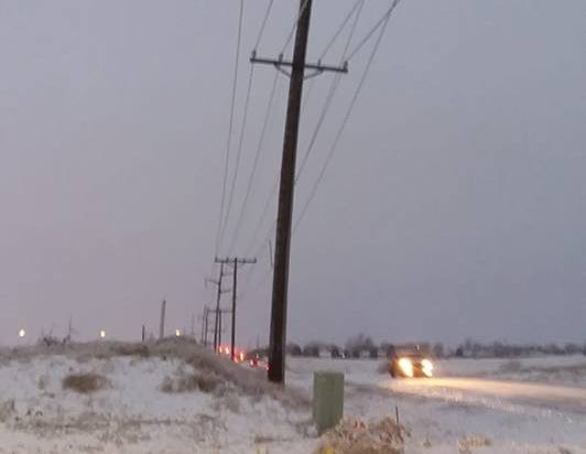 Power lines bending near Marion Road in northwestern Sioux Falls.