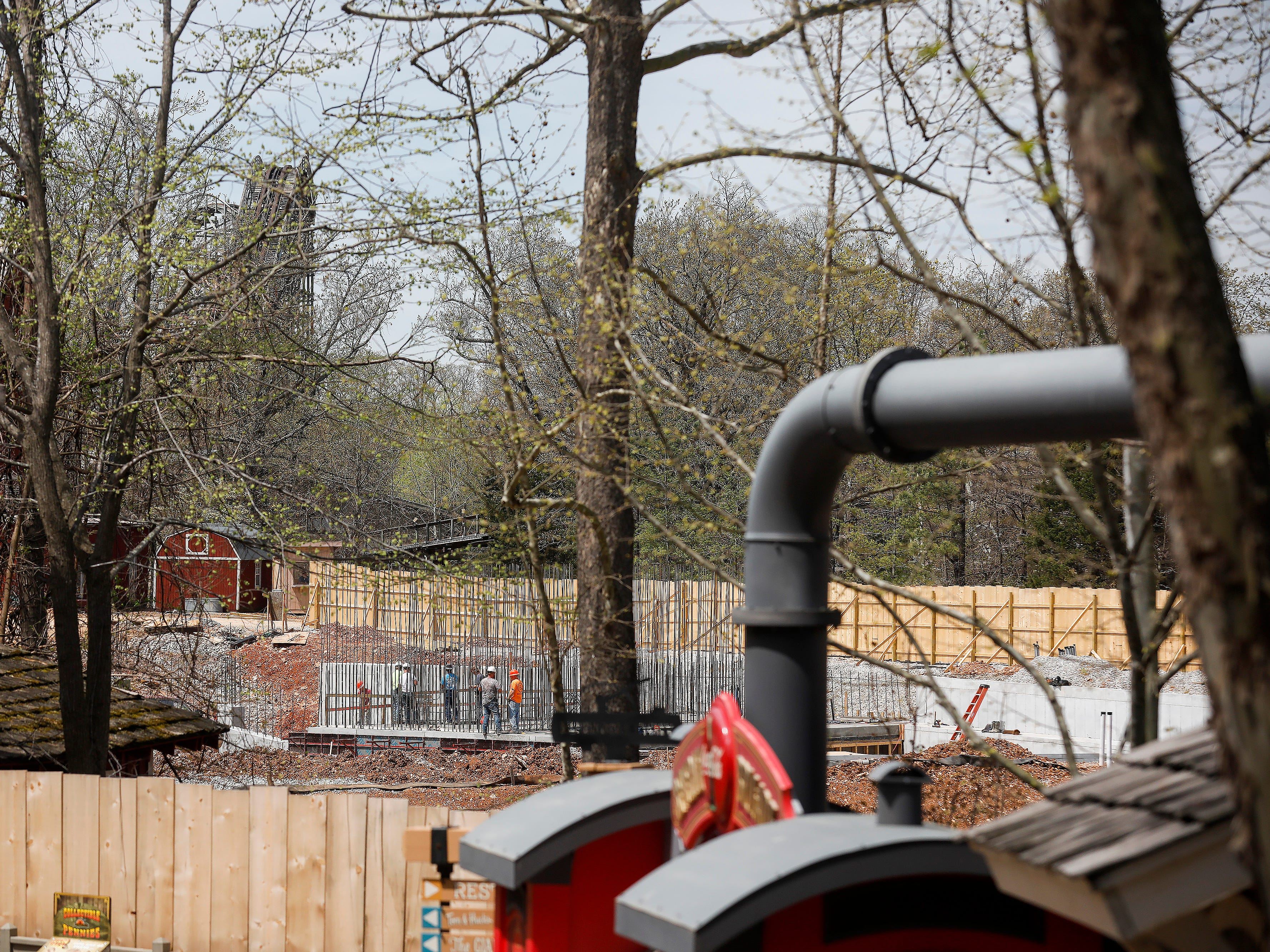 A construction crew works on a new attraction at Silver Dollar City on Wednesday, April 10, 2019.