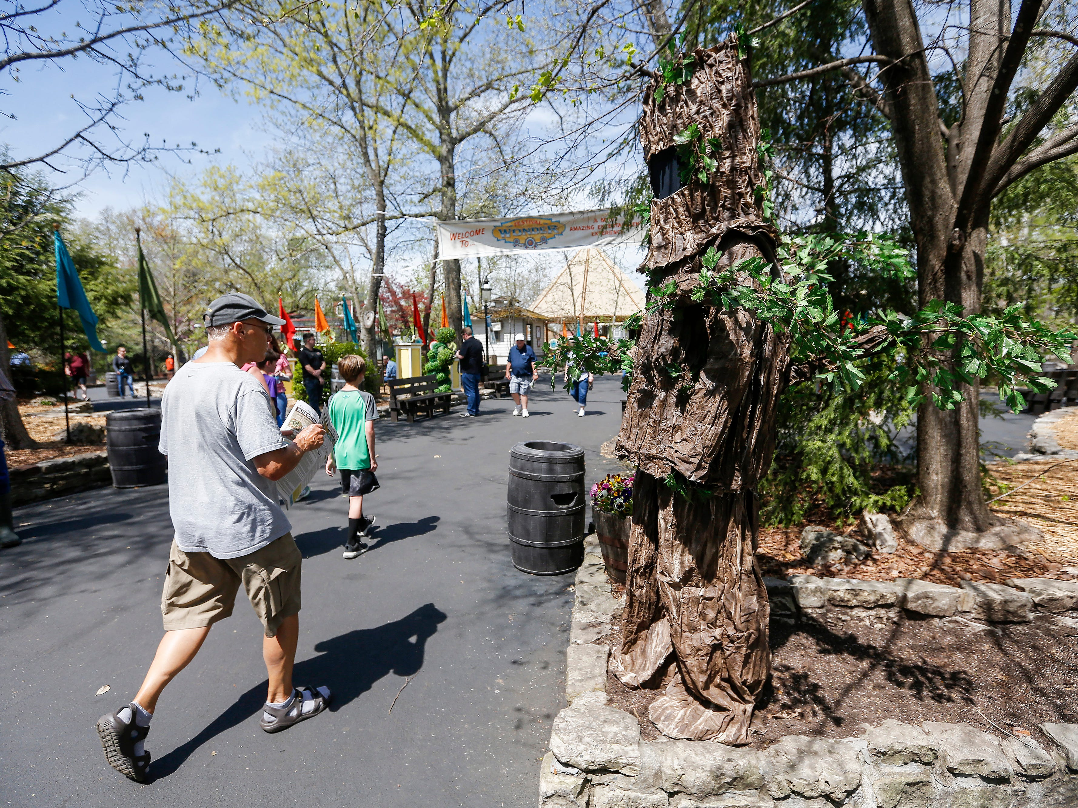 A living tree, right, greets patrons as they walk through the entrance during the Festival of Wonder on Wednesday, April 10, 2019 at Silver Dollar City. The event runs Wednesdays through Sundays, April 10-28.