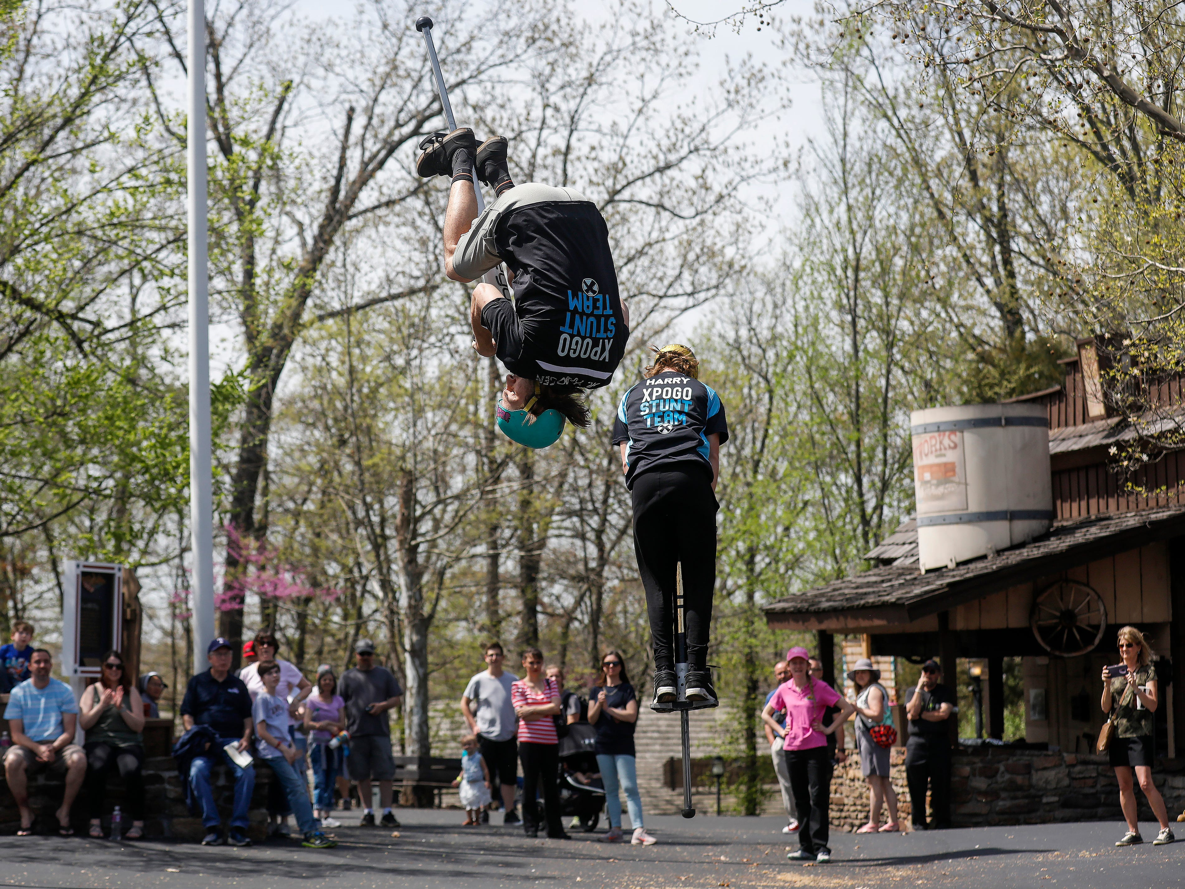 Russ Kaus, left, and Harry White, members of the X-Pogo Stunt Team, perform as a part of Festival of Wonder on Wednesday, April 10, 2019 at Silver Dollar City. The event runs Wednesdays through Sundays, April 10-28.
