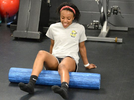 Alice Wardy works with a foam roller in the Mary Baldwin University training room.