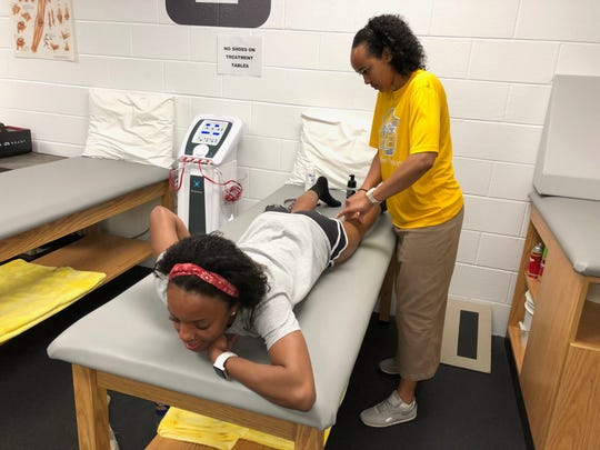 Mary Baldwin University's athletic trainer, Marah Jones, works on sophomore Alice Wardy's hamstring Tuesday afternoon.