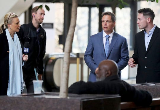 Media members approach Don Damond, the fiance of Justine Ruszczyk Damond, second from right, and Zach Damond, right, Don Damond's son, as they arrive for the opening arguments in the trial of former Minneapolis police officer Mohamed Noor at the Hennepin County Government Center for Tuesday, April 9, 2019, in Minneapolis. (David Joles/Star Tribune via AP)