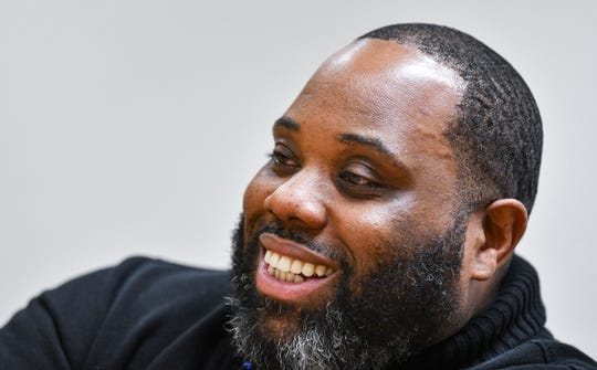 Sebastian Witherspoon smiles while talking about his work as director of equity services for St. Cloud school district during an interview Tuesday, April 2, at his office in Waite Park.