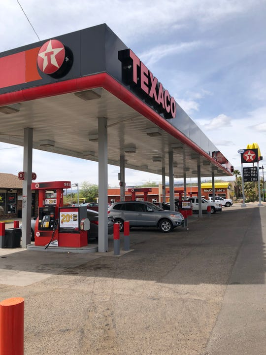 Several cars stop at a Texaco gas station in St. George, Utah, on April 11, 2019.