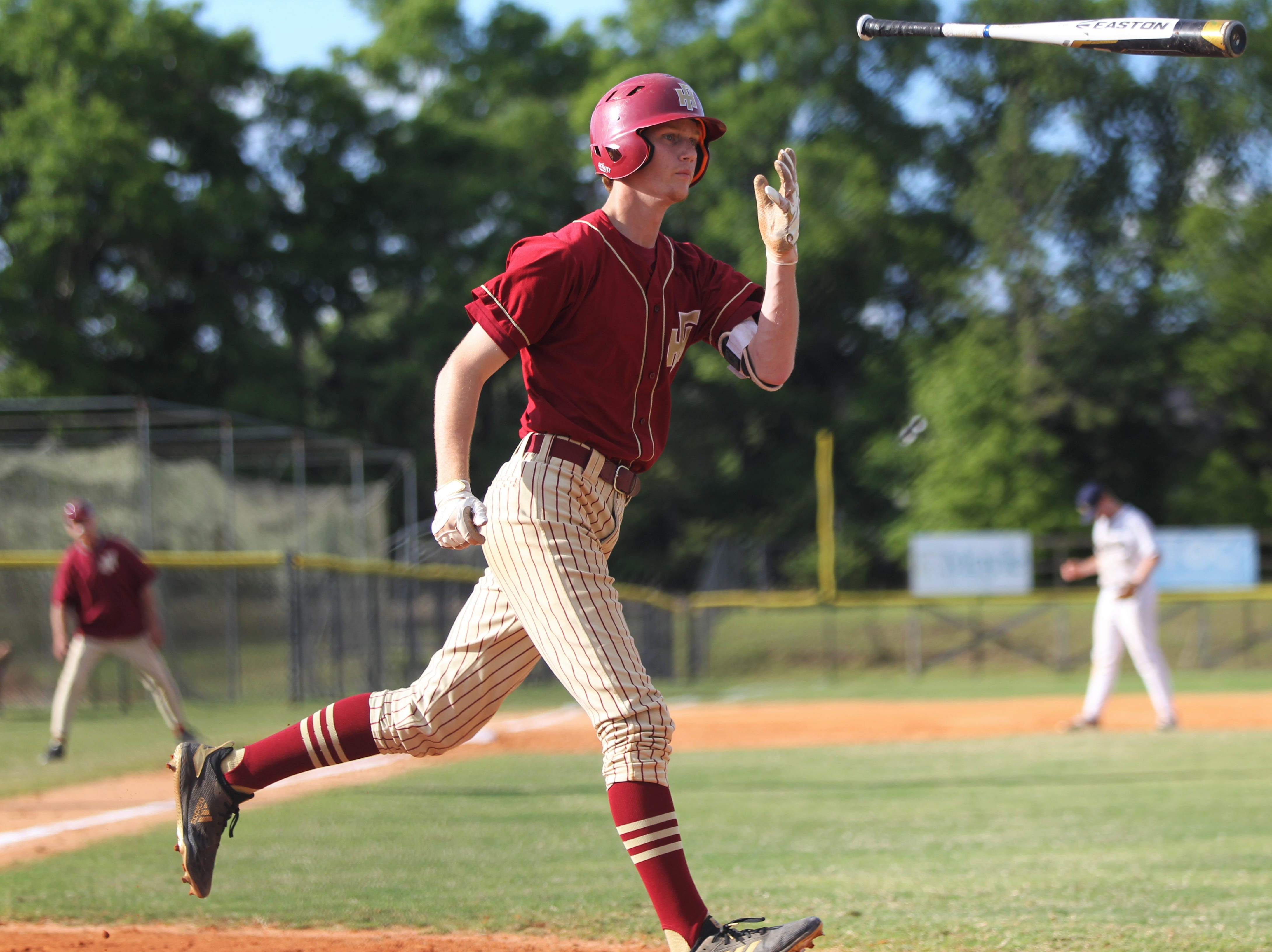 Florida High junior A.J. Thorp flips his bat after a walk as Florida High won 11-3 on the road at St. John Paul II on Tuesday, April 3, 2010.