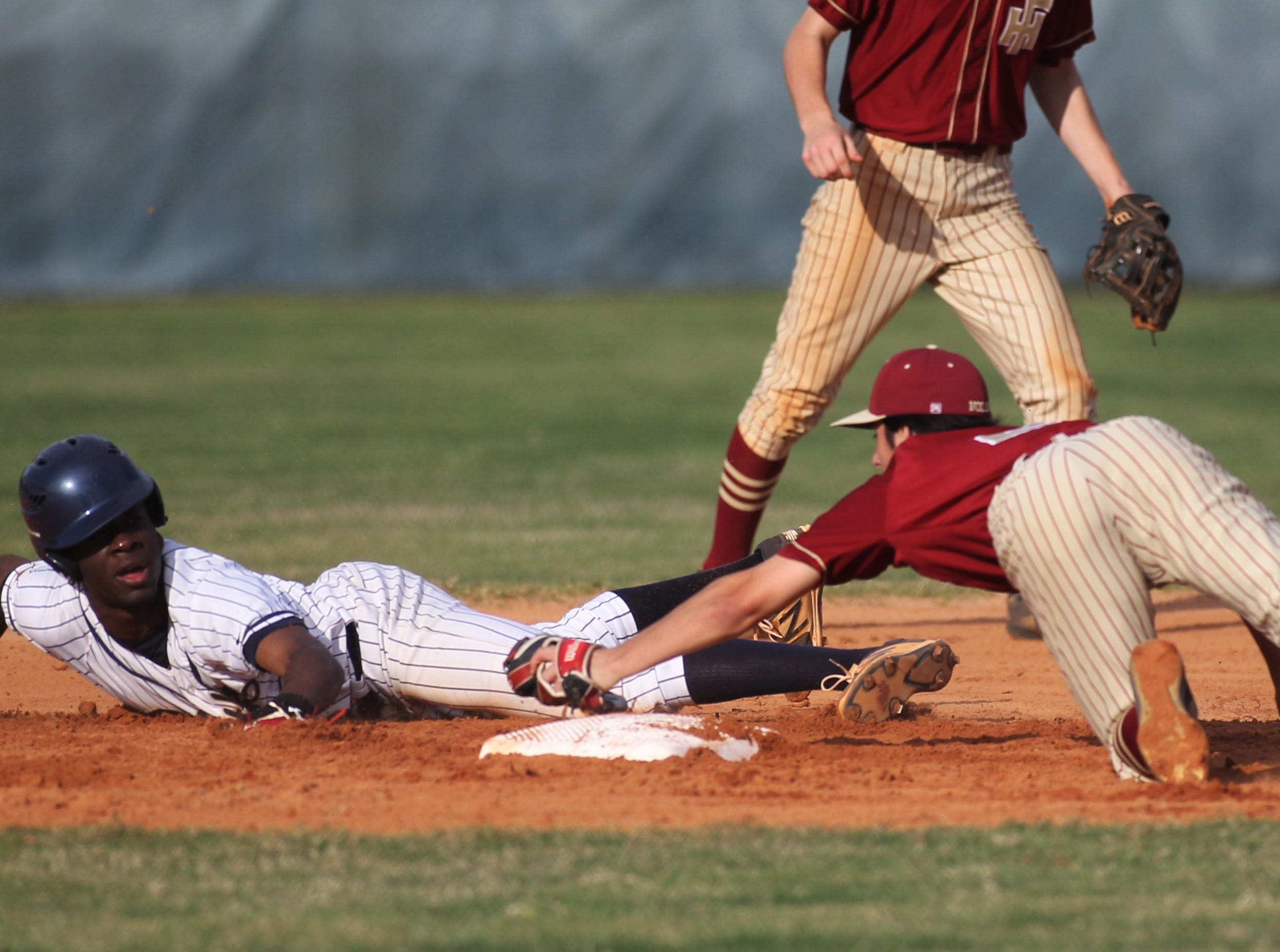 St. John Paul II senior Logan Roberts is tagged out on a steal attempt as Florida High won 11-3 on the road at St. John Paul II on Tuesday, April 3, 2010.