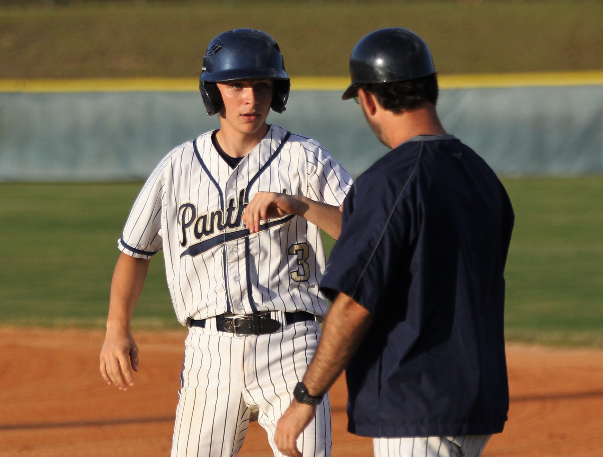 St. John Paul II sophomore Nathan Whitley gets congratulated after a hit as Florida High won 11-3 on the road at St. John Paul II on Tuesday, April 3, 2010.