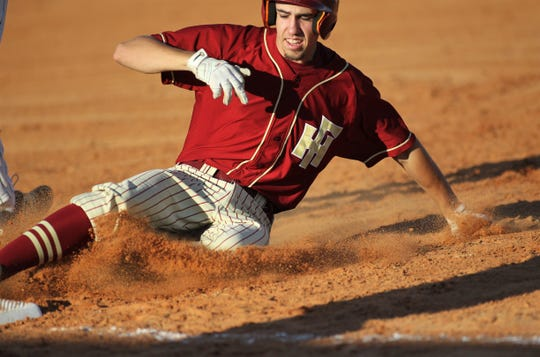 Florida High senior Bryson Mills slides in for a triple as Florida High won 11-3 on the road at St. John Paul II on Tuesday, April 3, 2010.