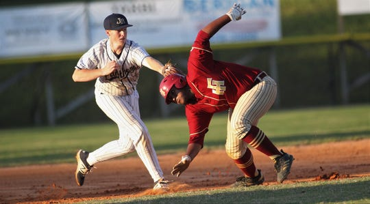 Florida High senior Malachi Burke is tagged out by St. John Paul II third baseman Chris Nichols during a rundown as Florida High won 11-3 on the road at St. John Paul II on Tuesday, April 3, 2010.