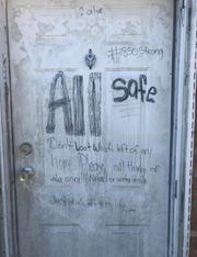 """This door brought contractor Brandon Miles to tears when he ran into it while bidding on a demolition job. """"This to me was so powerful in capturing the true heartbreak in what our neighbors here in the panhandle have been and are still enduring. My heart still hurts for everyone affected from this storm."""""""