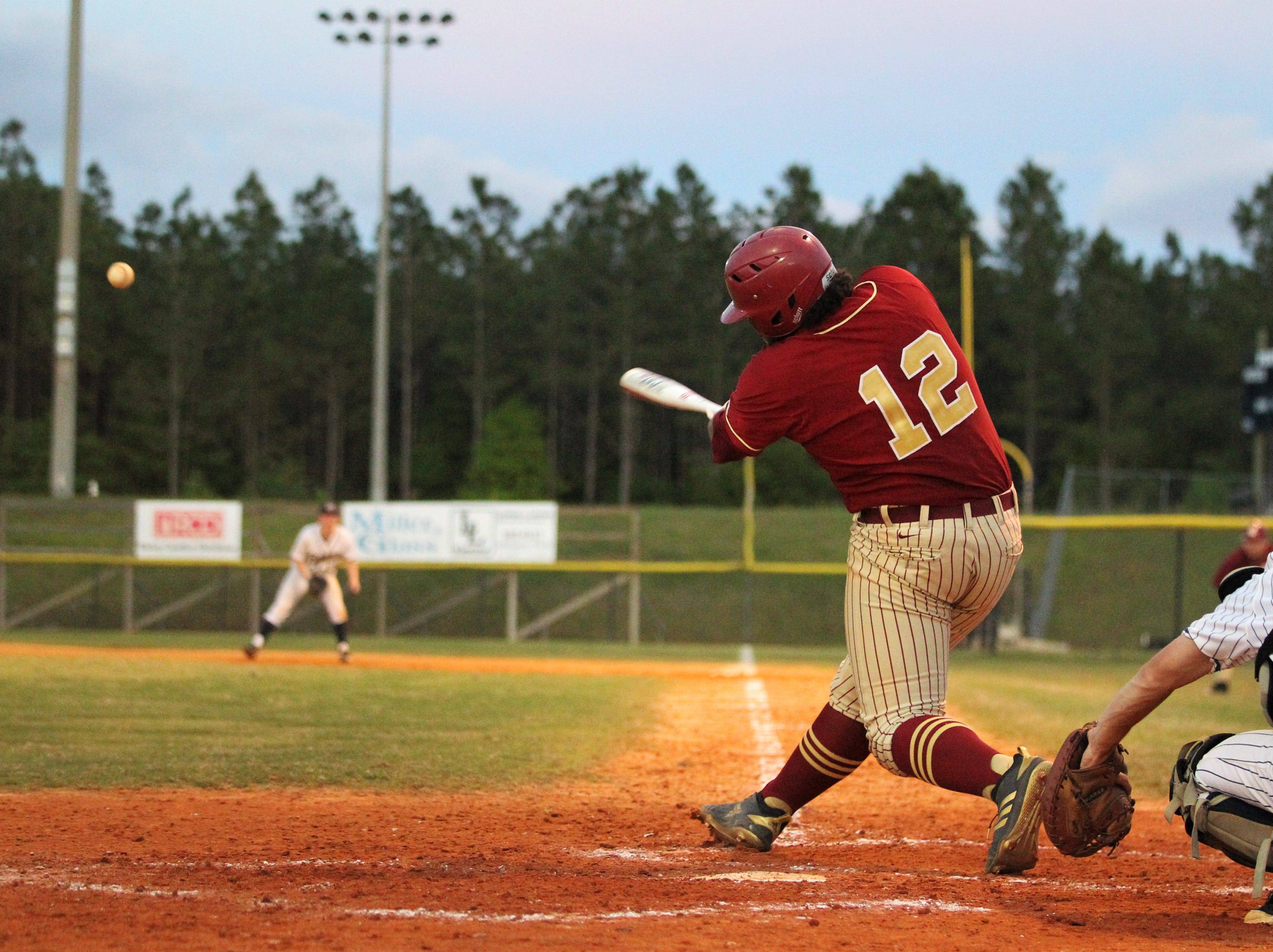 Florida High senior Malachi Burke laces a double as Florida High won 11-3 on the road at St. John Paul II on Tuesday, April 3, 2010.