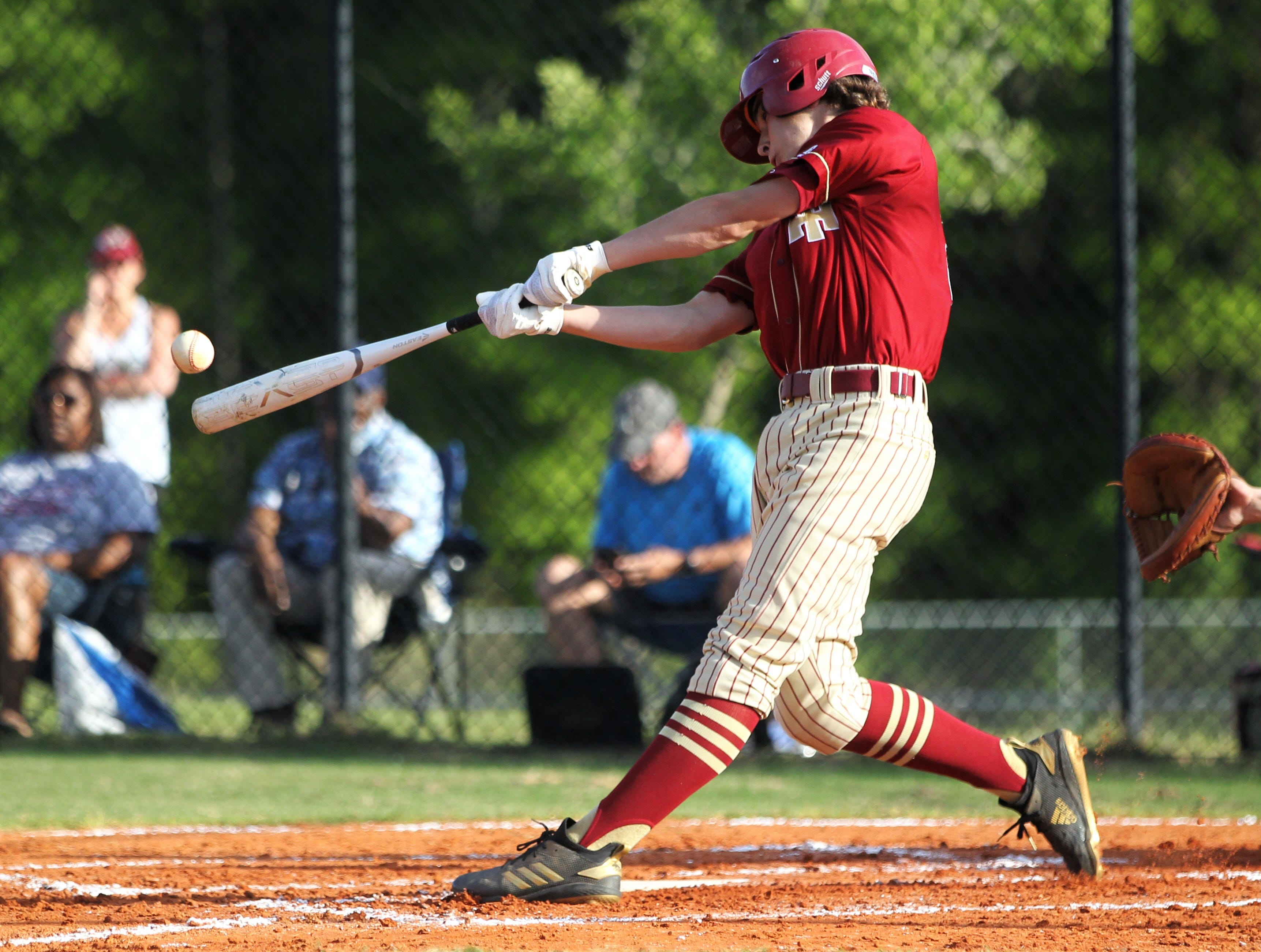 Florida High's Boone Hosey bats as Florida High won 11-3 on the road at St. John Paul II on Tuesday, April 3, 2010.