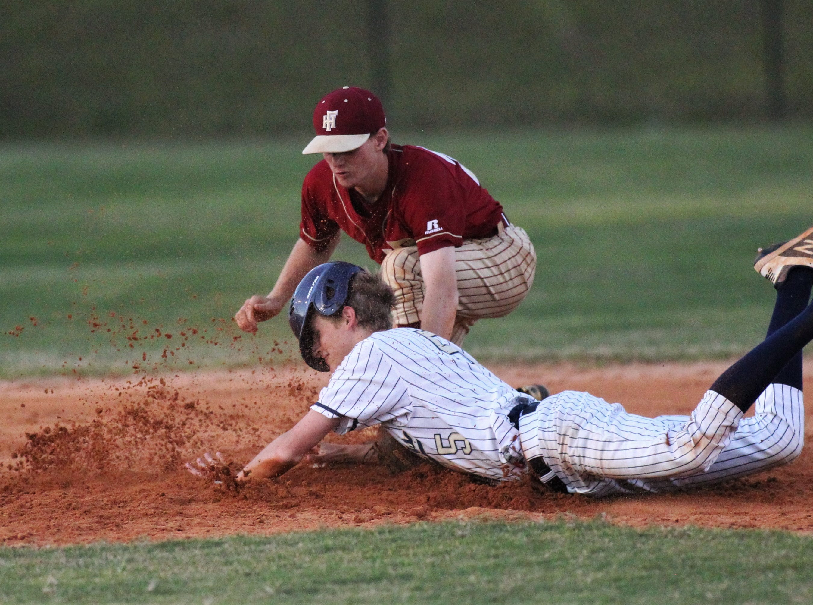 St. John Paul II junior Alex Ware is tagged out at second base by Florida High second baseman A.J. Thorp as Florida High won 11-3 on the road at St. John Paul II on Tuesday, April 3, 2010.