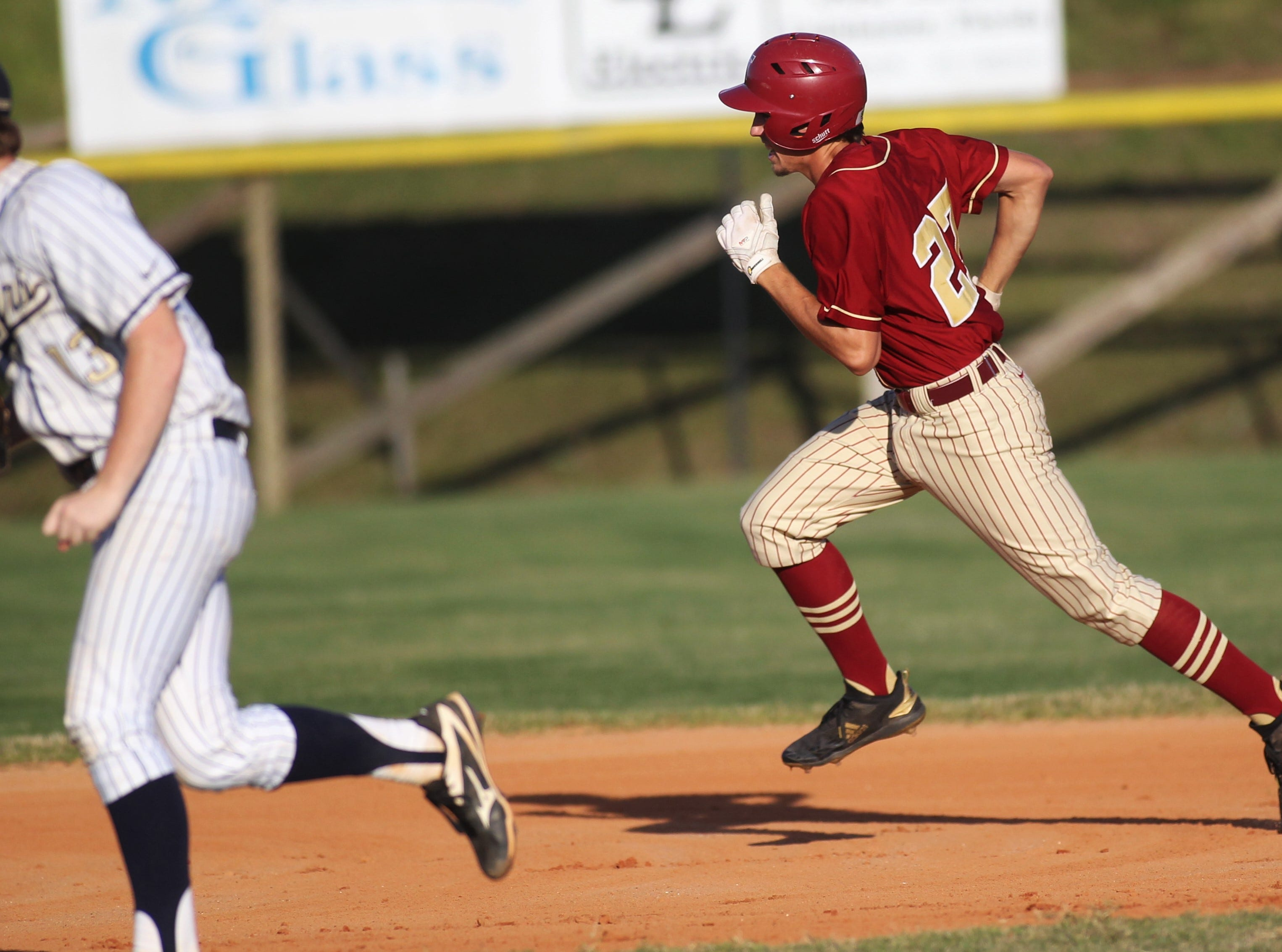 Florida High senior Bryson Mills runs towards second while while tripling as Florida High won 11-3 on the road at St. John Paul II on Tuesday, April 3, 2010.