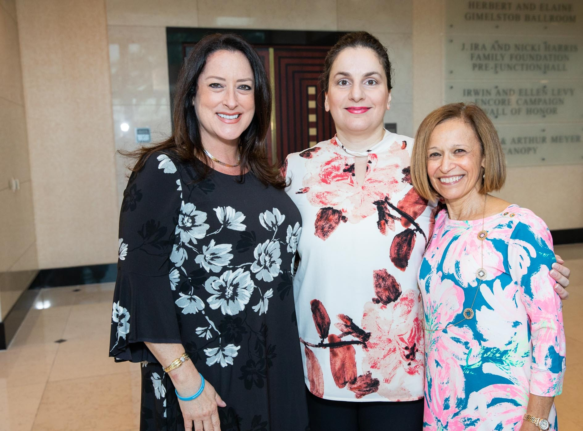 Michelle Martin Carr, left, Elena Peroulakis and Donna Goldfarb attend Catch the Wave of Hope's breakfast to raise money and awareness about human sex trafficking.