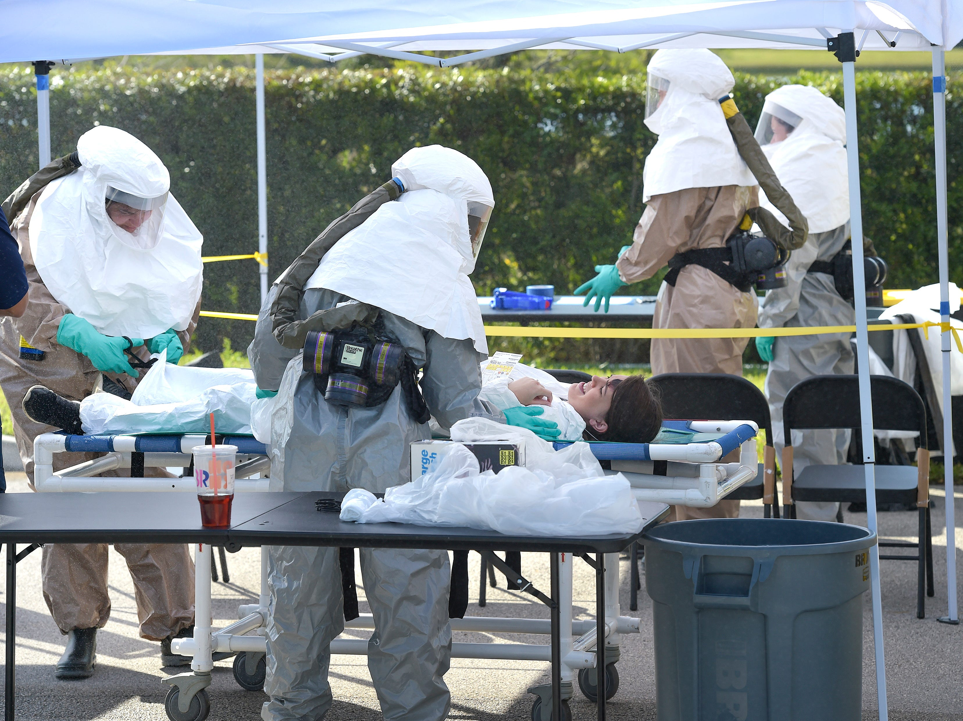 Hospital Emergency Response Team (HERT) members from the Cleveland Clinic Tradition hospital staff receive victims involved in a mock terrorist incident, preparing them to go through a decontamination process, before admission into the hospital ER during a disaster preparedness exercise on Thursday, April 11, 2019, in the Tradition development of Port St. Lucie. All the Cleveland Martin Heath Hospitals, along with the Central Florida Disaster Medical Coalition are participating in the disaster preparedness exercises.