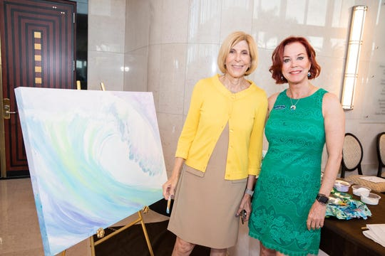 Former West Palm Beach Mayor Jeri Muoio, left, and Lynne Barletta attend Catch the Wave of Hope's breakfast to raise money and awareness about human sex trafficking.