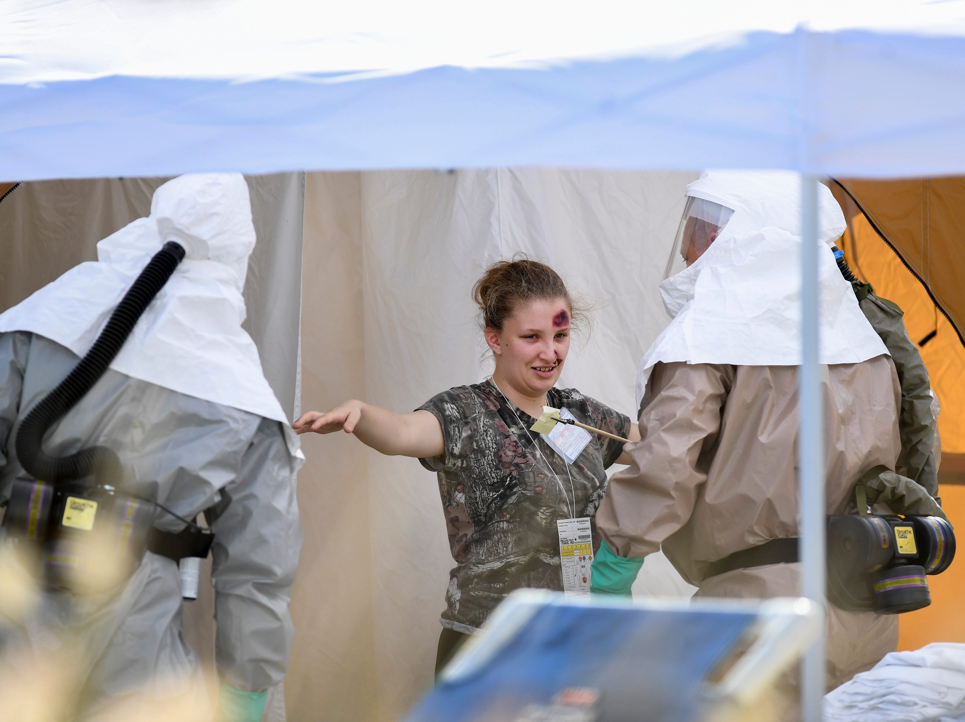 """Sadie Peters, 18, a junior at St. Lucie West Centennial High School, plays the part of a victim going through decontamination and being treated by the Hospital Emergency Response Team, HERT, at the Cleveland Clinic Tradition Hospital on Thursday, April 11, 2019, during full-scale disaster preparedness exercises. """"It helps to save a life,"""" Peters said. More than 150 high school students are participating, playing the roll of victims, during the exercise. Cleveland Clinic Martin Health hospitals, along with the Central Florida Disaster Medical Coalition, are participating in the exercises."""
