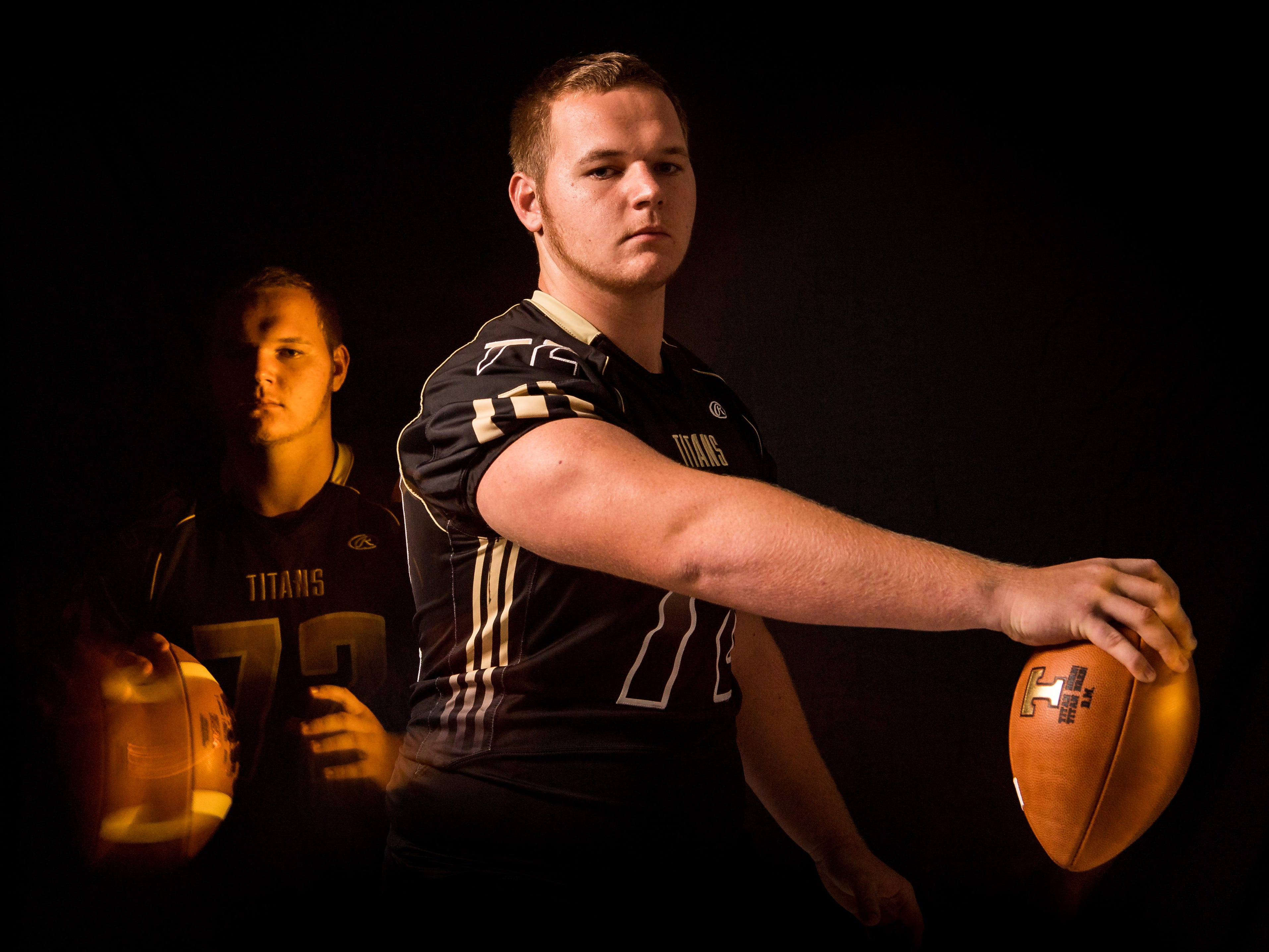 James Wayne, center with Treasure Coast High School football, is photographed Wednesday, April 10, 2019, at TCPalm in Stuart.