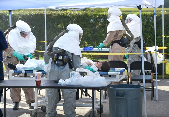 Hospital Emergency Response Team (HERT) members, from the Cleveland Clinic Tradition hospital staff, receive victims involved in a mock terrorist incident, preparing them to go through a decontamination process, before admission into the hospital ER during a disaster preparedness exercise on Thursday, April 11, 2019, in Port St. Lucie.