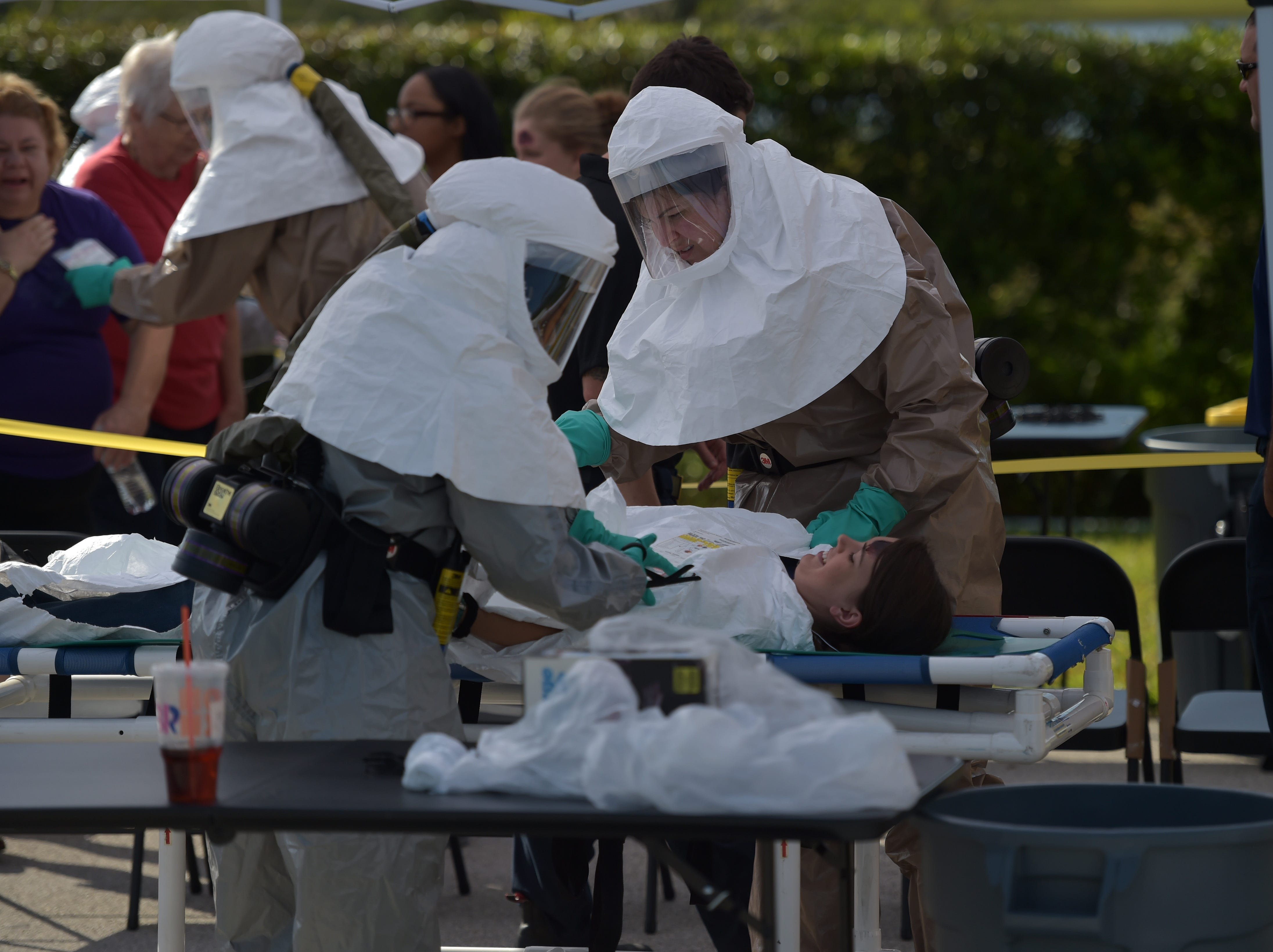 Hospital Emergency Response Team members, HERT, from Cleveland Clinic Tradition receive victims involved in a mock terrorist incident, preparing them to go through a decontamination process before admission into the hospital ER during a disaster preparedness exercise on Thursday, April 11, 2019 in the Tradition development of Port St. Lucie. All the Cleveland Martin Heath Hospitals, along with the Central Florida Disaster Medical Coalition are participating in the disaster preparedness exercises.