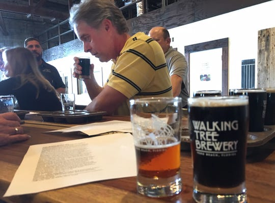 Gil Smart, opinion columnist for TCPalm, samples beer styles at Walking Tree Brewery Wednesday, Feb. 27, 2019, during TCPalm's annual newsroom retreat. After the meeting, several of TCPalm's staff members stayed behind to sample some of the beer styles offered at Walking Tree.