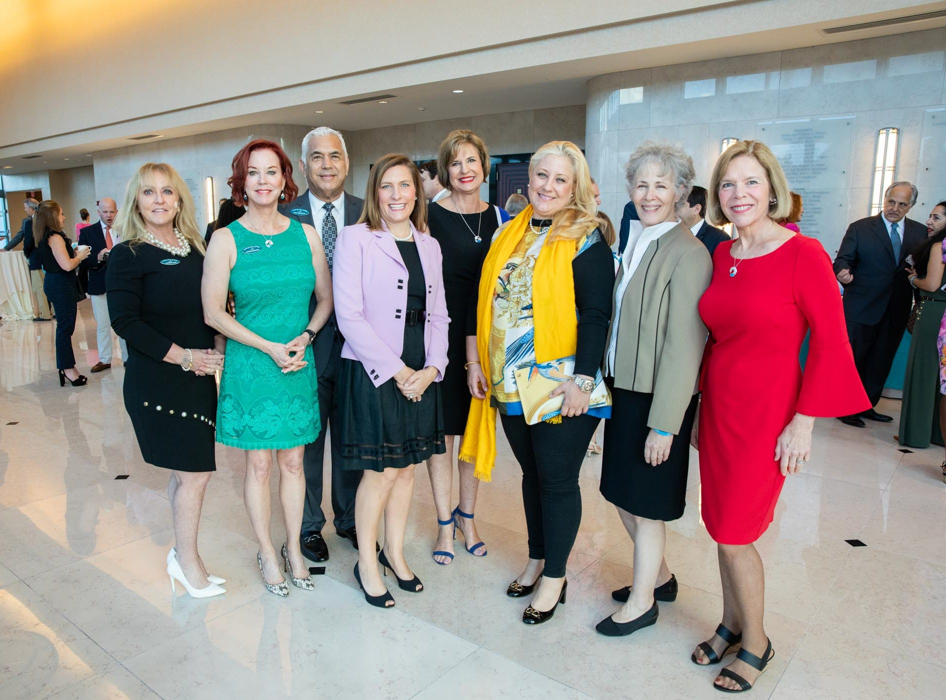 Catch the Wave of Hope supporters and board members, from left, Candace Lopes, Lynne Barletta, Tony Barletta, Kelly Laurine, Janice Norman, Denise Fraile, Jolinda Porfidio and Mona Salisbury at the Kravis Center in West Palm Beach.