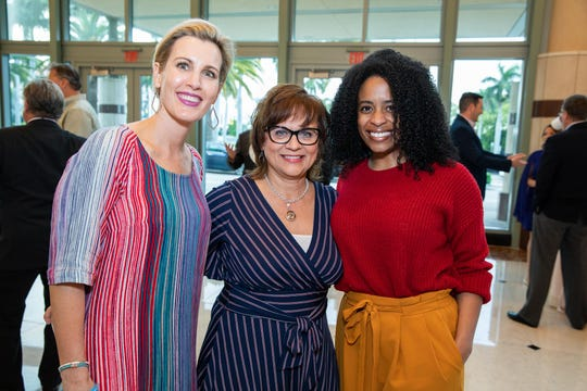Dawn Connelly, left, Bonnie Jo Daniels and Krysten Albertini attend Catch the Wave of Hope's breakfast to raise money and awareness about human sex trafficking.