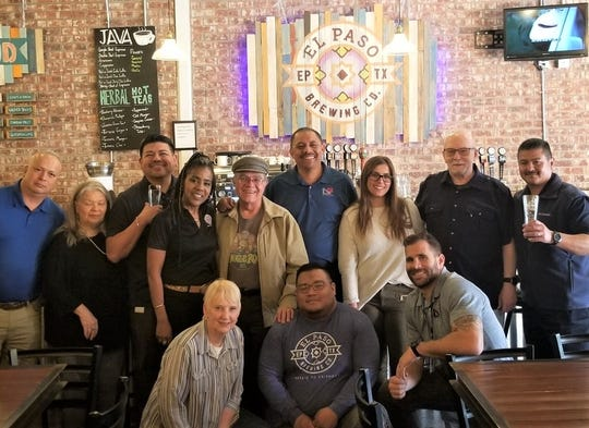 Sharon Walter, El Paso Brewing Co., co-owner, left front, and Nick LaMantia, L&F Distributors part owner, front right, other El Paso Brewing owners, staff, and L&F staff, celebrate the addition of the brewery's craft beers to L&F's distribution portfolio.