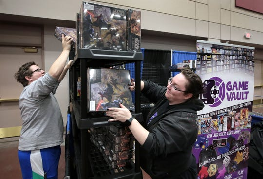 Matt Zielewski and Lyndi Barnard set up the Game Vault booth at El Paso Comic Con on Thursday, April 11, 2019, in preparation for the weekend. Comic Con runs Friday through Sunday at the El Paso convention center. Celebrity guests include Star Trek's Levar Burton, Power Rangers' Jason David Frank, Steve Cardenas and Paul Schrier, among others.