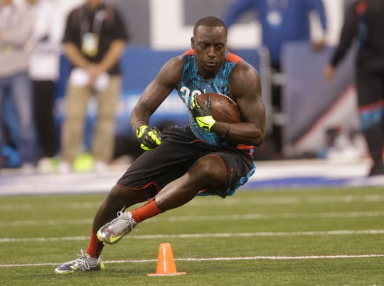 Cierre Wood runs a drill during the NFL football scouting combine in Indianapolis in 2013.
