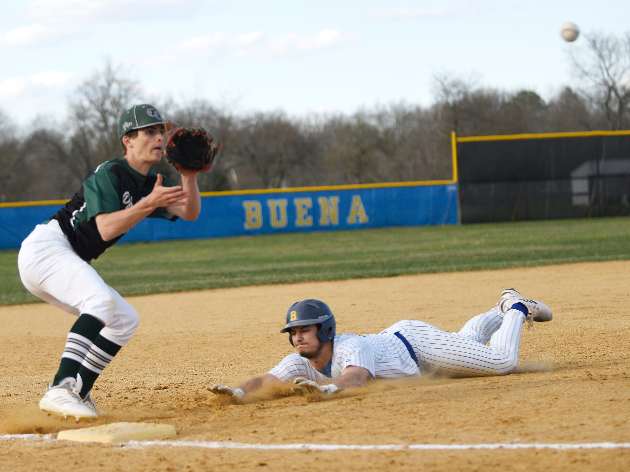 Buena catcher Jake Guglielmi steals third base during a game against Cedar Creek on Wednesday, April 10, 2019.