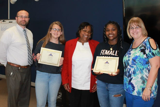 (From left) Spike Cook, principal of Lakeside Middle School, student Julia Thompson, Carole Green, chairperson of Delta Sigma Theta Sorority, student Ajahnee Cooper, and Melissa Sooy, eighth grade teacher at Lakeside, were present as the students were recognized for placing in the sorority's essay contest.