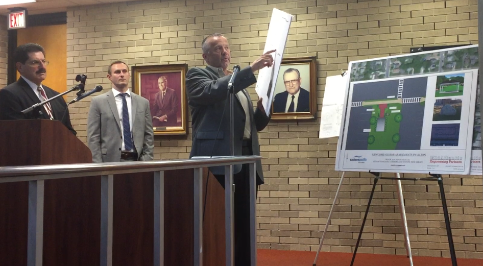 Developer Hans Lampart (right) points out a design feature for his project to build senior high rises on the former Newcomb hospital property in Vineland. Lampart was testifying before the city Planning Board, which approved the project after a last-minute redesign. Left-right: Project attorney Charles Gabage and engineer Kevin Shelly.