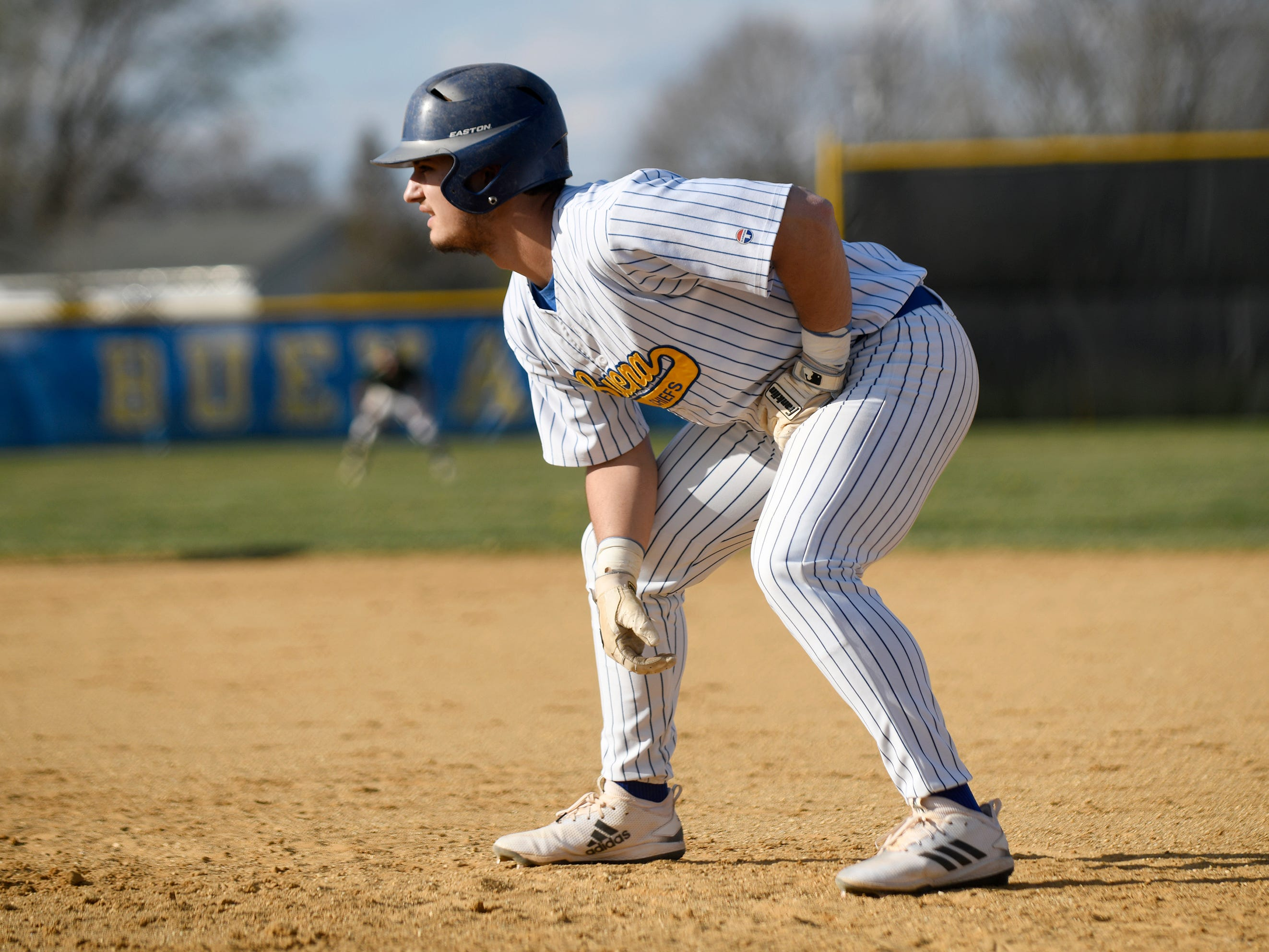 Buena catcher Jake Guglielmi looks to steal a base during a game against Cedar Creek on Wednesday, April 10, 2019.