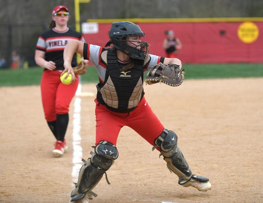 Vineland catcher Devin Coia makes a play at first base during a game against Millville on Monday, April 8, 2019.