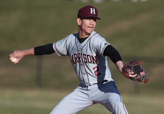 Harrison's Greg Lucien (2) pitching against Byram Hills during baseball action at Byram Hills High School in Armonk April 10,  2019. Byram Hills won the game 3-1.