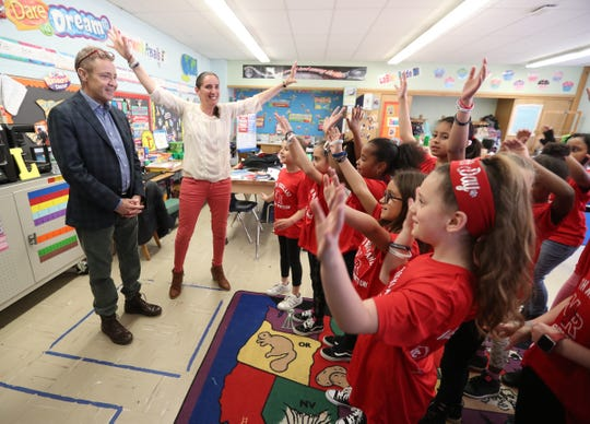 Stony Point Elementary School students of Jen LaBier's third grade class sing Jerry Cahill a song on Thursday, April 11, 2019.