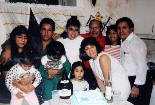 A family photo of Salvador Ramirez from Yonkers, top row, second from left, and his niece Diana Rojas, front row center, in this photo, photographed April 11, 2019.  Ramirez went missing in 1993.