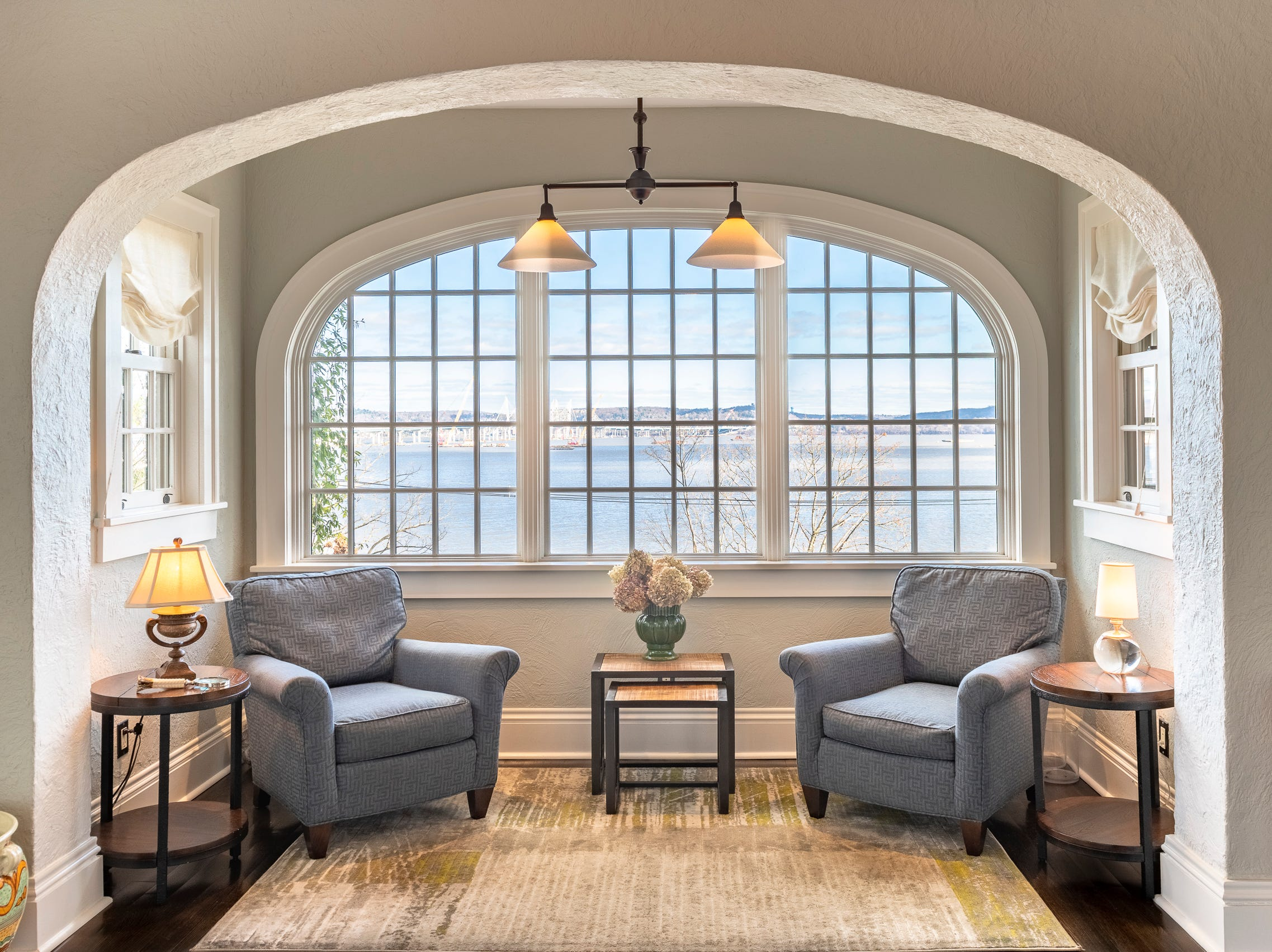 The home boasts four working fireplaces, a beautiful butler's pantry, powder room, large eat-in kitchen with radiant heat, formal dining room, spacious center entry hall, living room and charming sun room with beautiful curved original windows.