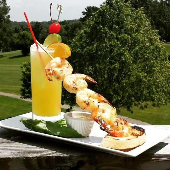 Tequila Sunrise and grilled shrimp at Woods Tavern Bar & Grill in  Ossining.