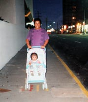 A family photo of Salvador Ramirez from Yonkers, pushing his daughter Sophia in 1992, in this photo, photographed April 11, 2019.  Ramirez went missing in 1993.