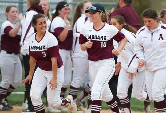 Appoquinimink pitcher Kourtney McNatt (10) leaves the postgame handshakes with third baseman Madeline Olivas after McNatt threw a perfect game in Appoquinimink's 3-0 home win against Mount Pleasant on Thursday.