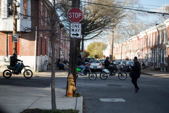 People ride dirt bikes through the streets of Wilmington's East Side neighborhood on April 10.
